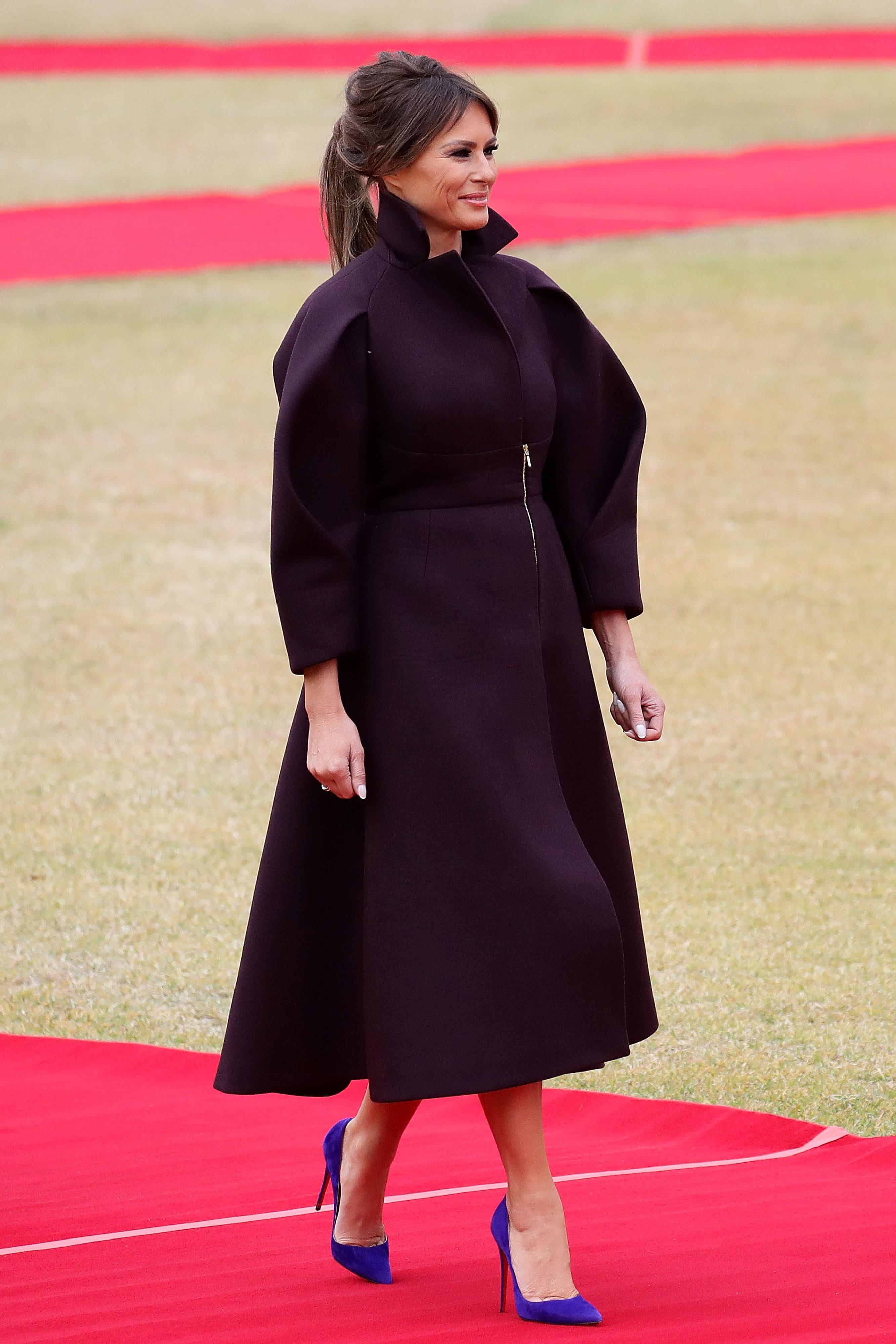 5f3b6415b Melania Trump stuns in plum Delpozo coat while arriving in Seoul ...