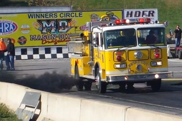 Fire engine pulls burnout on drag strip