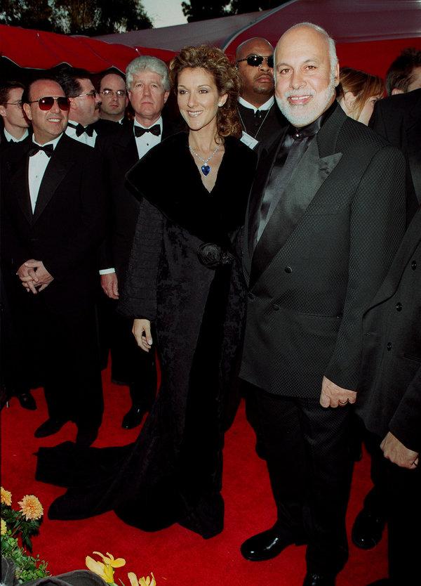 (Original Caption) Celine Dion and her husband Rene Angelil arrive at the Shrine auditorium. (Photo by...