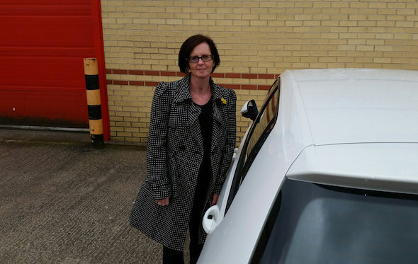 "Niall McCarthy's wife Amanda with their car parked on their drive - where they received a parking ticket. See MASONS story MNTICKET: A man was shocked to return home from work to find traffic wardens had slapped a parking ticket on his car - despite it being parked on his drive. Niall McCarthy, 49, has been using his tiny driveway since 2002 and hasn't had any problems with parking fines before. He has even propped a piece of wood in front of his house which allows the family to drive within a centimetre of their wall without hitting the building. He said: ""It is just laughable really. The car was as tight to the house as we can get it."