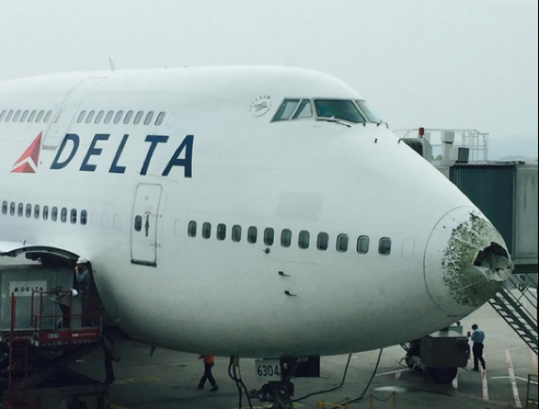 Plane left with huge hole in nose after hailstorm