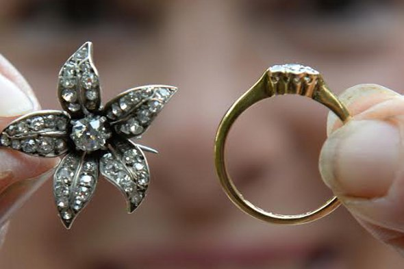 The diamond ring and brooch found in the chair.