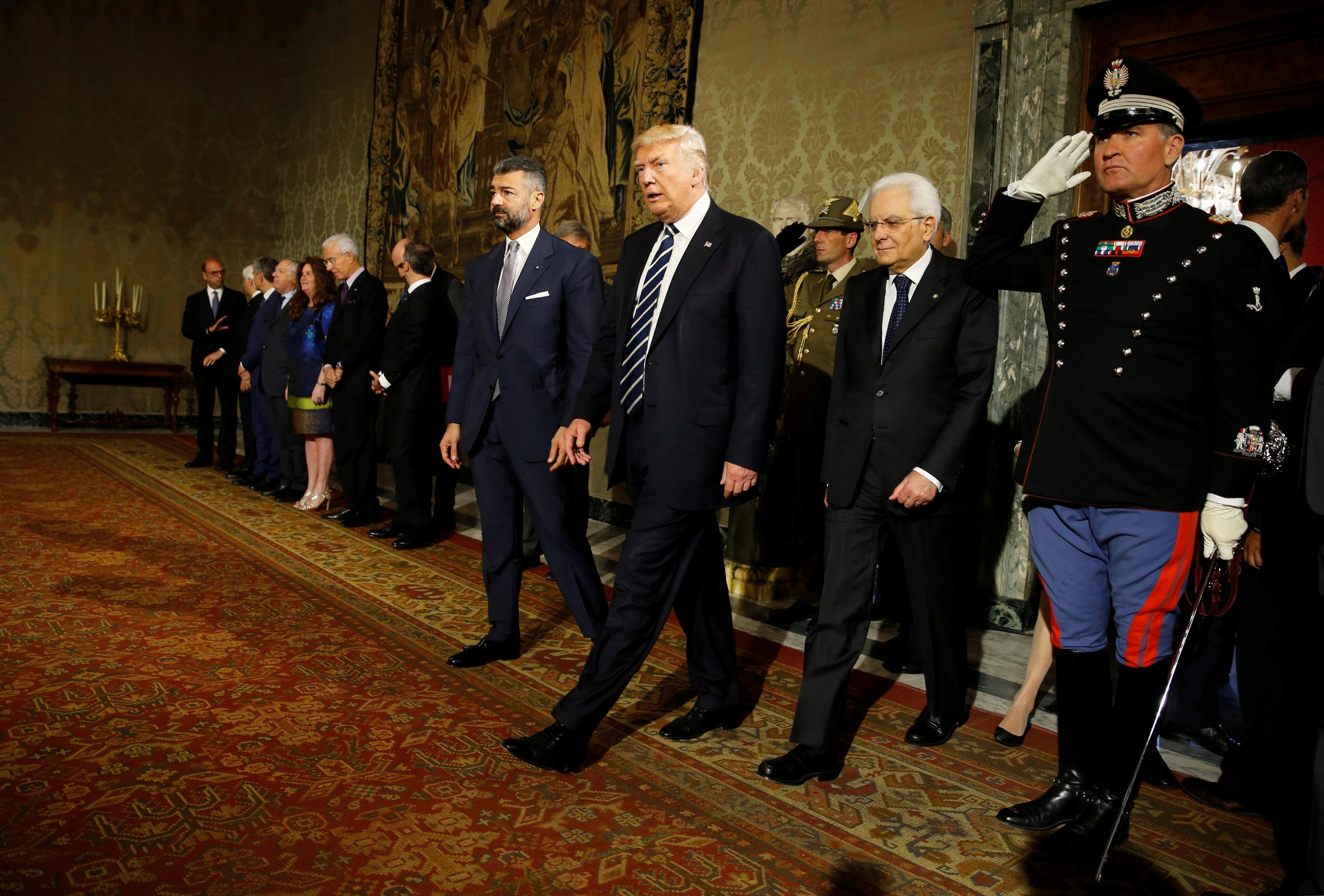 U.S. President Donald Trump walks beside Italy's President Sergio Mattarella (2ndR) at the Quirinale...