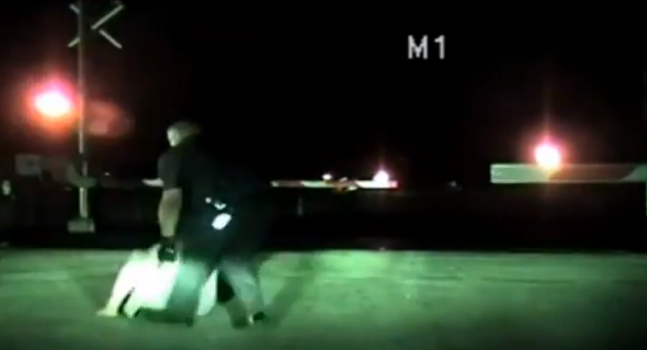 policeman saves woman on tracks from oncoming train