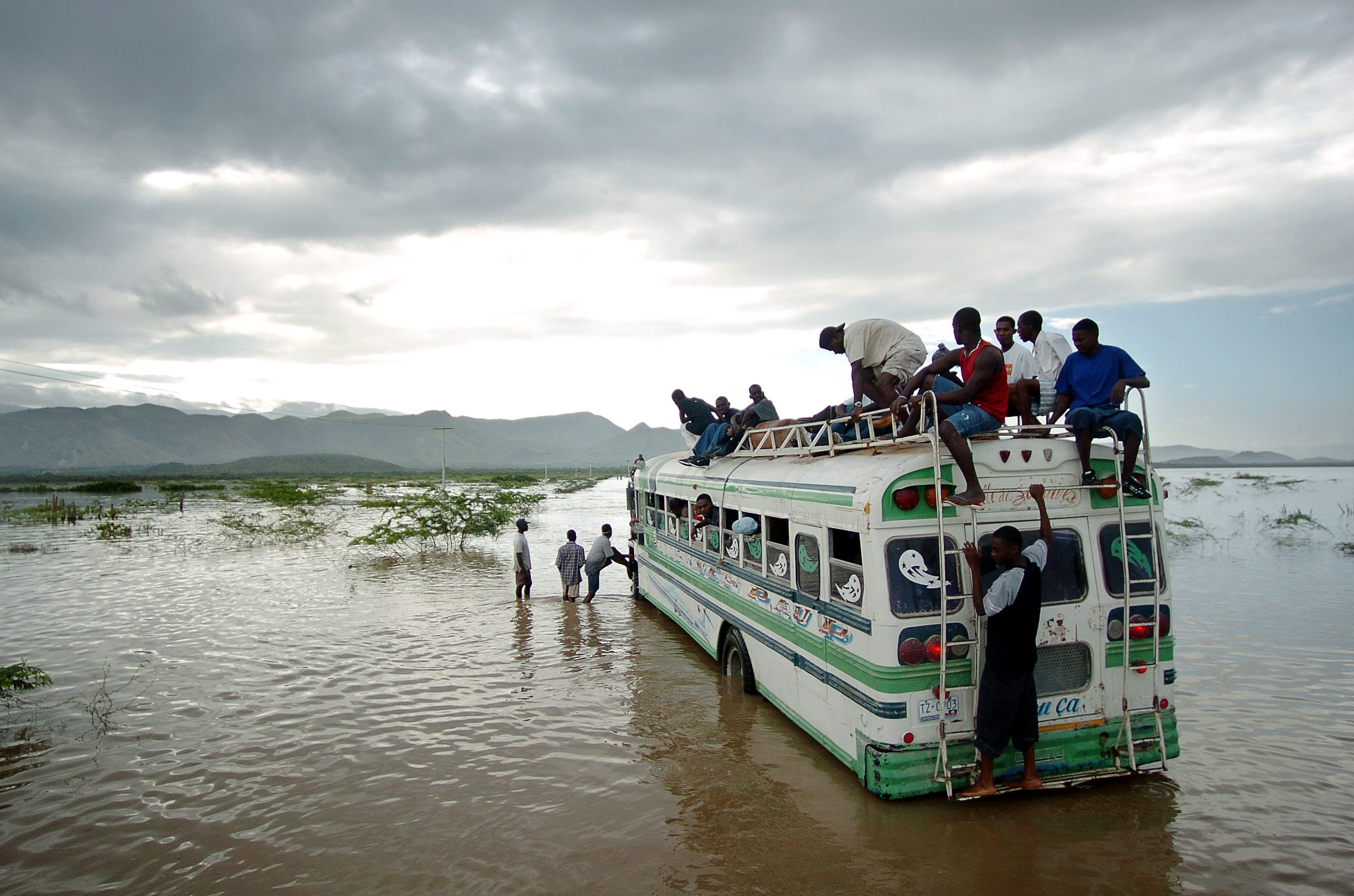 A bus filled with Haitian people after Hurricane Jeanne devastates the area