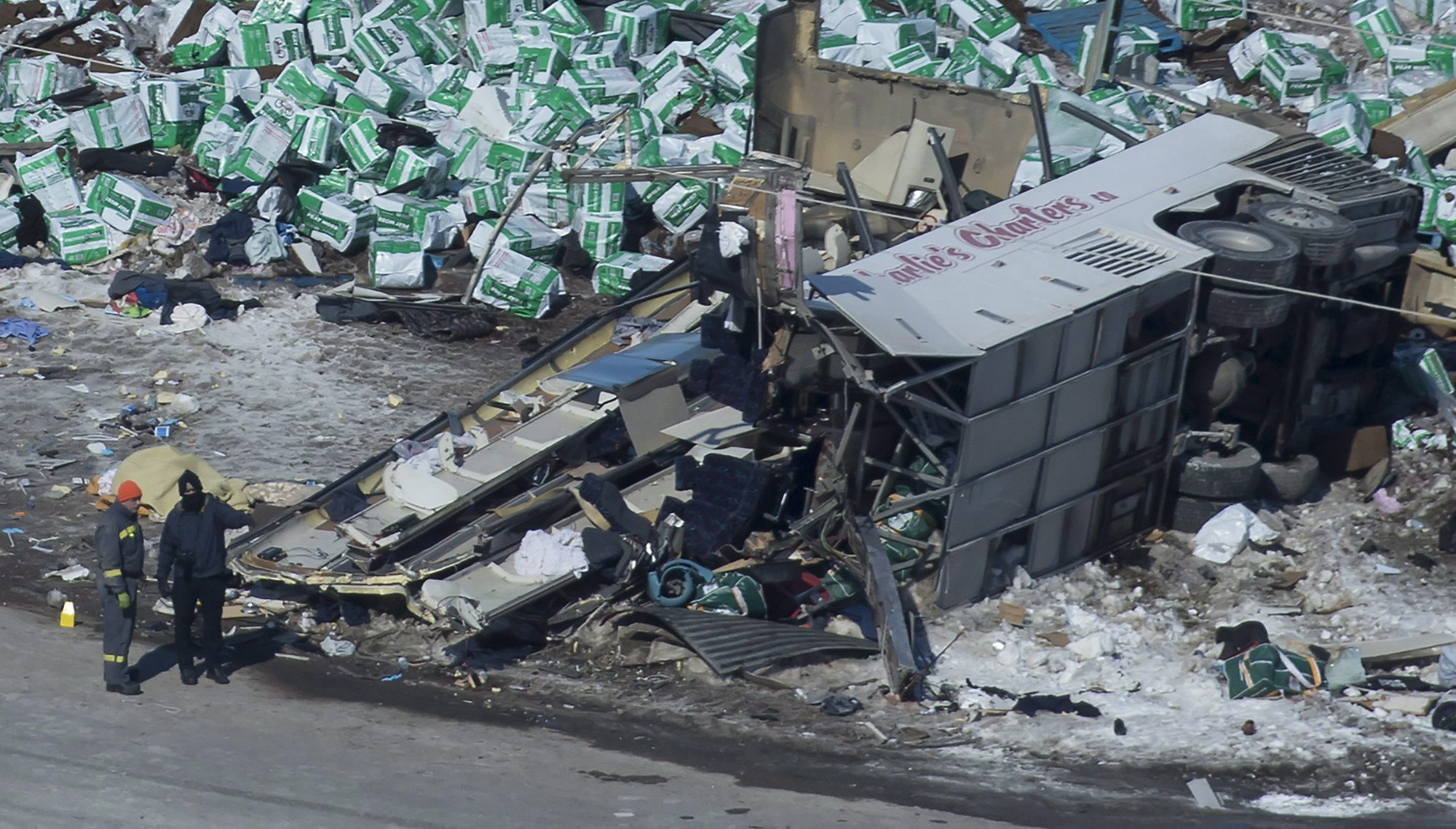 The wreckage of a fatal crash outside of Tisdale, Sask., is seen Saturday. A bus carrying the Humboldt...