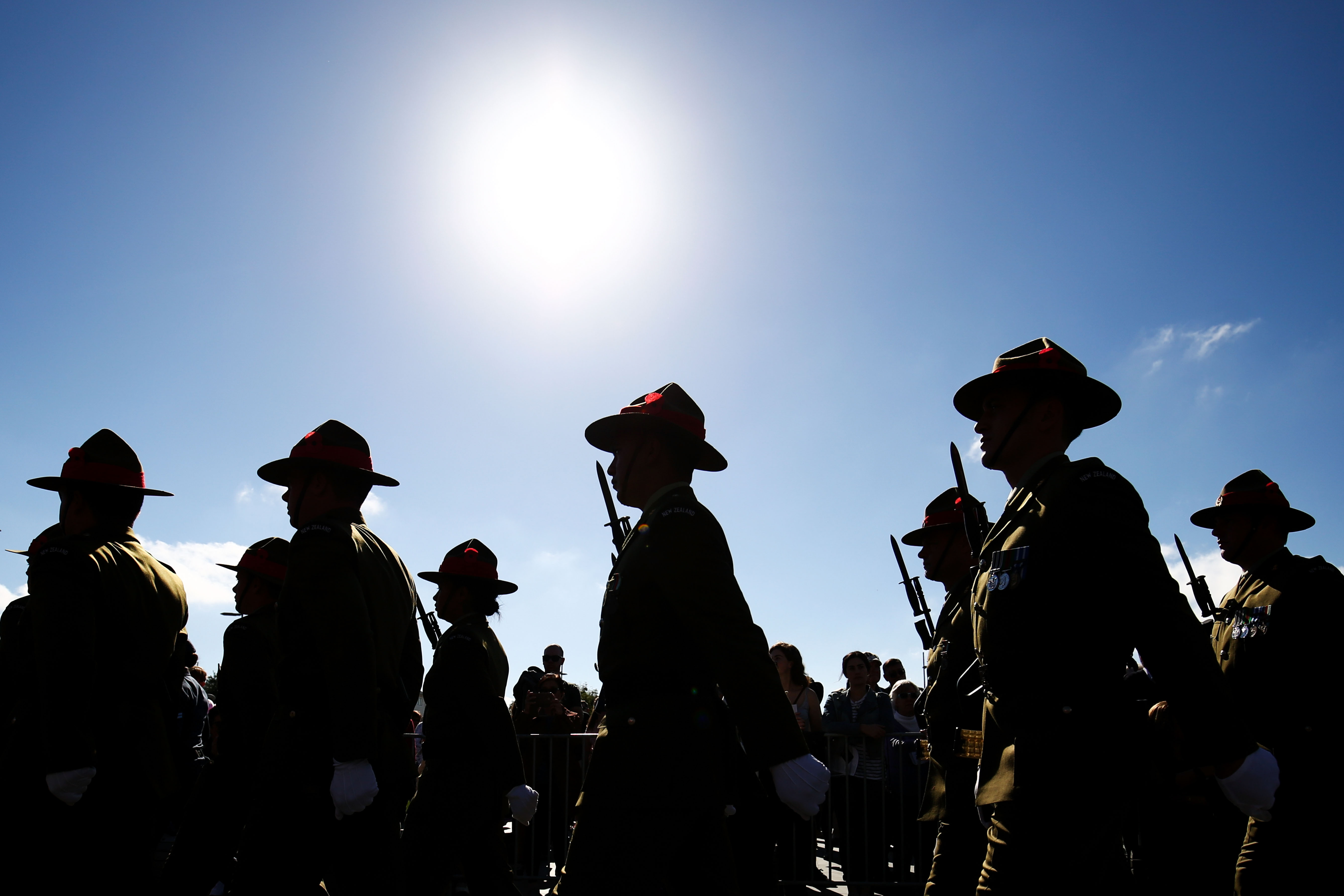 Soldiers march during the Anzac Day National Commemoration