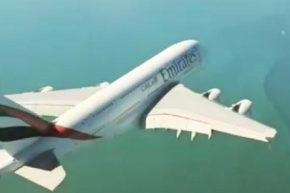 World's biggest passenger plane flies right under helicopter (video)