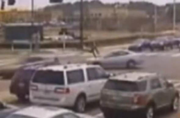 Cartwheeling motorcyclist walks away unharmed after car crash