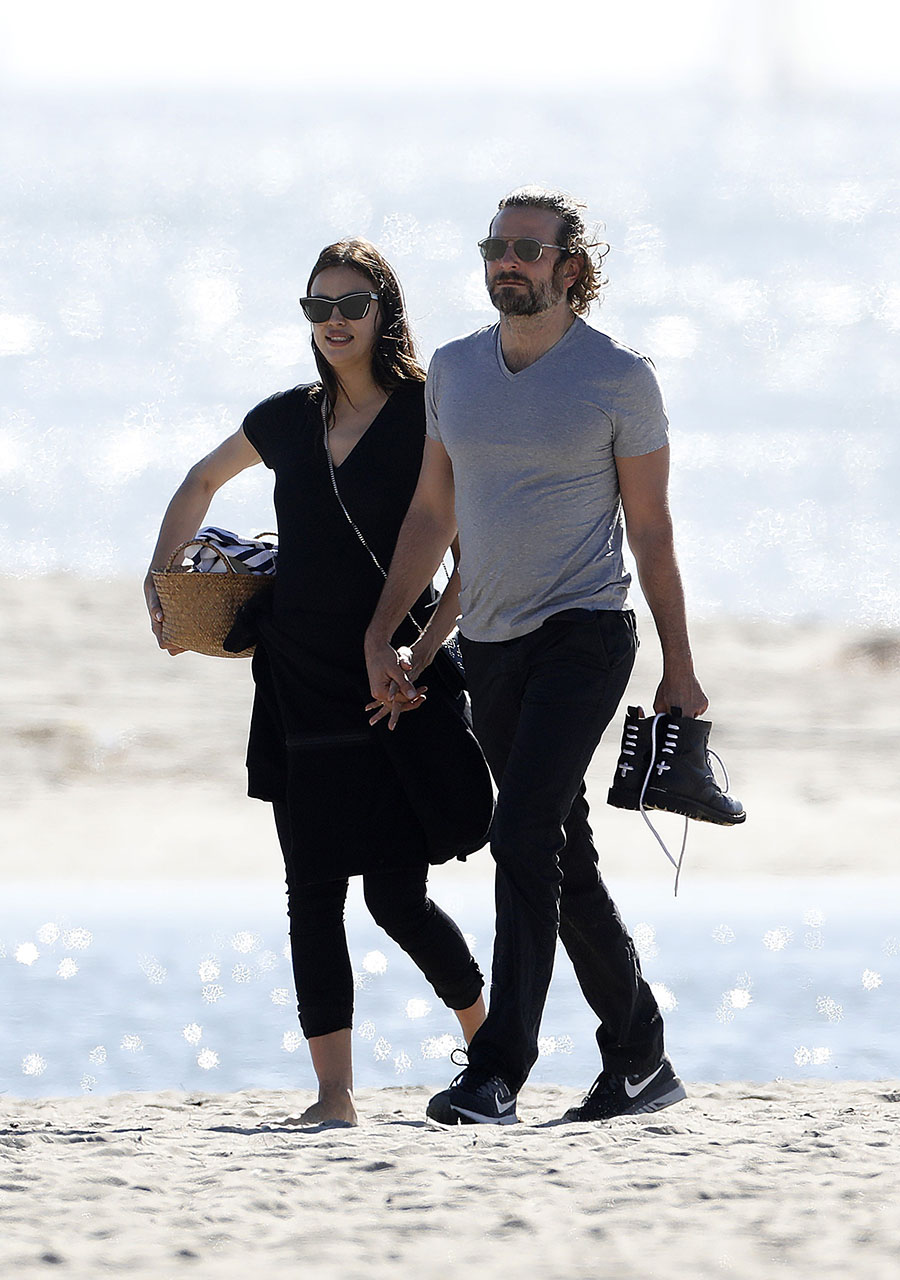 AG_677090 - ** RESTRICTIONS: WORLDWIDE EXCEPT IN ITALY, SPAIN **  -     *PREMIUM-EXCLUSIVE* **MUST CALL FOR PRICING** - Venice, CA - Bradley Cooper and Irina Shayk bring their own lunch to the beach and cuddle after enjoying their meal. The couple look sweet and in love as Bradley helps Irina stand up so they can leave hand in hand.  Pictured: Bradley Cooper, Irina Shayk  AKM-GSI 14 FEBRUARY 2017    Maria Buda (917) 242-1505 mbuda@akmgsi.com   Mark Satter (317) 691-9592 msatter@akmgsi.com or sales@akmgsi.com