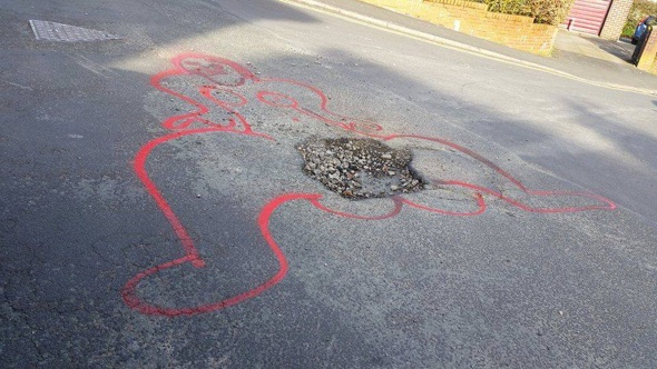 Crusader draws giant penises around Britain's potholes