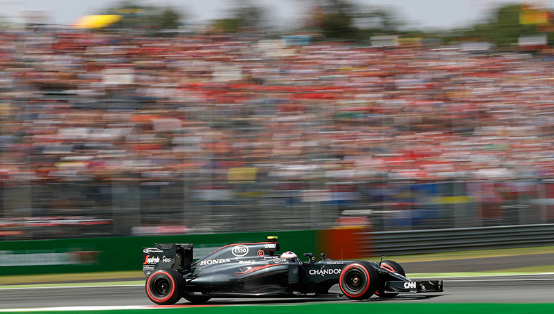 Britain's driver Jenson Button steers his McLaren during the qualifying session for Sunday's Italian Formula One Grand Prix at the Monza racetrack, Italy, Saturday, Sept. 3, 2016.