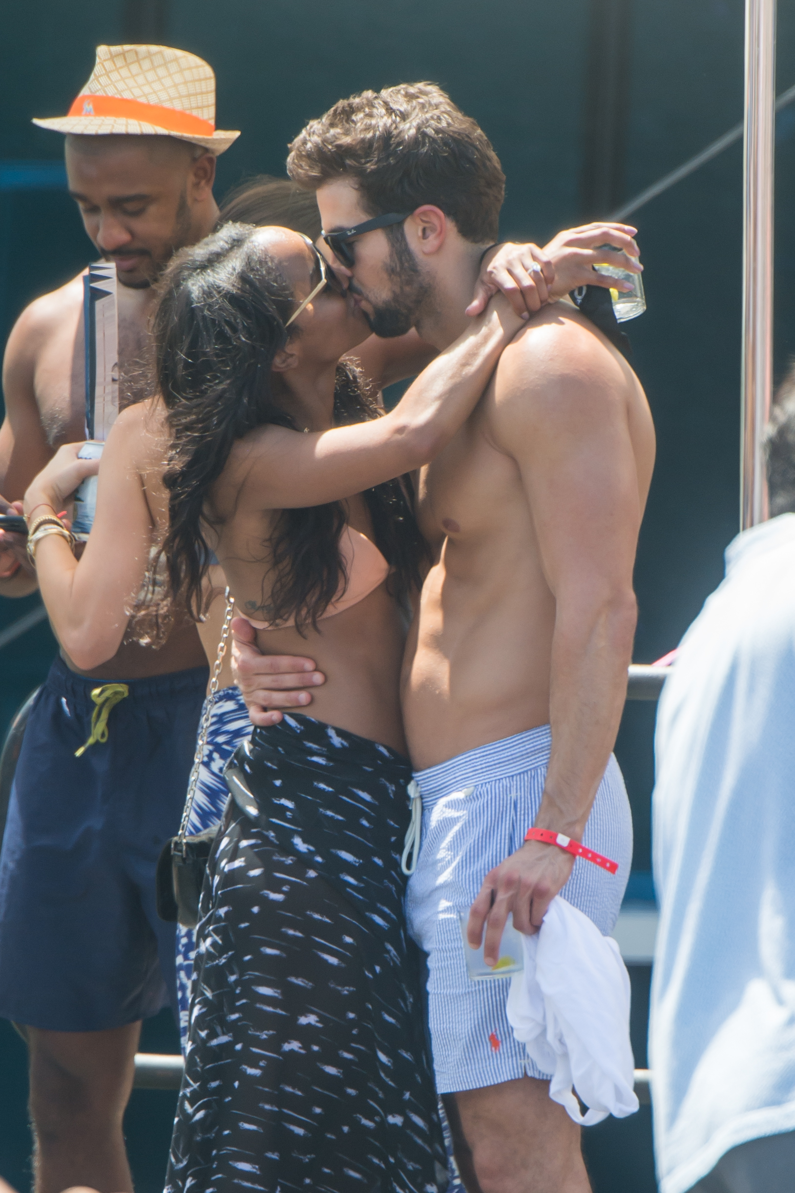 Bachelorette Rachel Lindsay and her newly fiancee Bryan Abasolo are seen at a pool party in Miami Beach. The two were joined by friends and were looking deeply in love while kissing each other under the Florida sun.  <P>  <B>Ref: SPL1558419  190817  </B><BR/> Picture by: AM/Splashnews<BR/> </P><P> <B>Splash News and Pictures</B><BR/> Los Angeles:	310-821-2666<BR/> New York:	212-619-2666<BR/> London:	870-934-2666<BR/> photodesk@splashnews.com<BR/> </P>