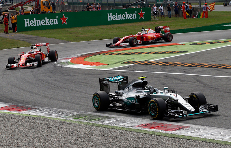 Mercedes driver Nico Rosberg of Germany leads the field ahead of Ferrari drivers Sebastian Vettel of Germany, left, and Kimi Raikkonen of Finland after the start of the Italian Formula One Grand Prix at the Monza racetrack, Italy, Sunday, Sept. 4, 2016.