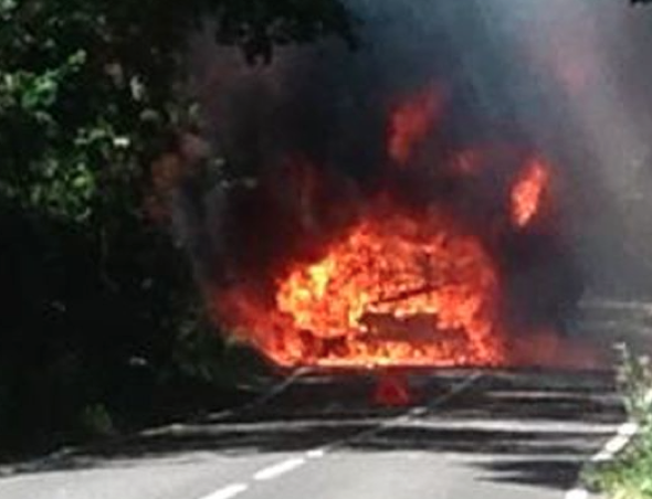 Famous footballer helps couple as camper van goes up in flames