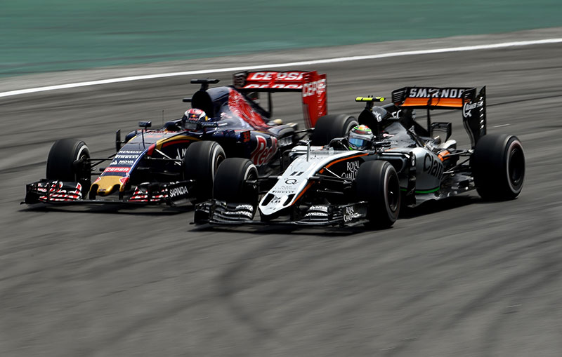 Max Verstappen and Sergio Perez battle at the 2015 Brazilian Grand Prix.