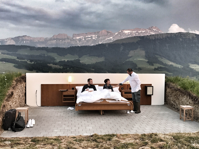 Open air hotel room is bed on top of a mountain