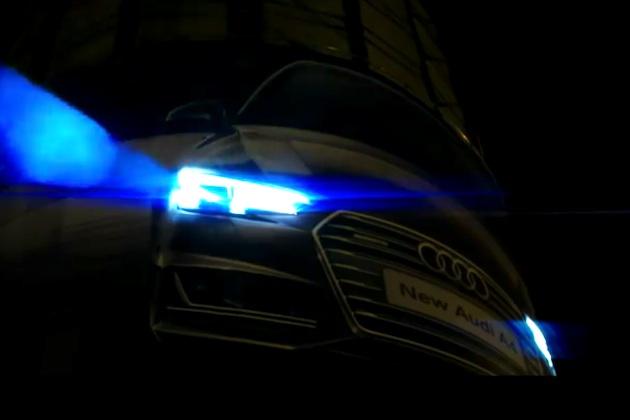 【ビデオ】自動制御ヘッドライトで夜間の交差点を見守る、アウディの屋外広告が出現!