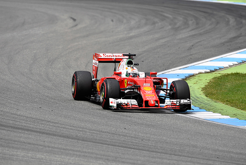 Ferrari driver Sebastian Vettel of Germany takes a curve during the German Formula One Grand Prix in Hockenheim, Germany, Sunday, July 31, 2016.