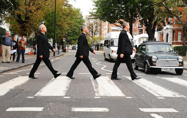 The Priests, (from left to right) of Eugene O'Hagan, Martin O'Hagan and David Delargy crossing the zebra crossing  outside Abbey Road Studios where they are busy recording their second album 'Harmony'.