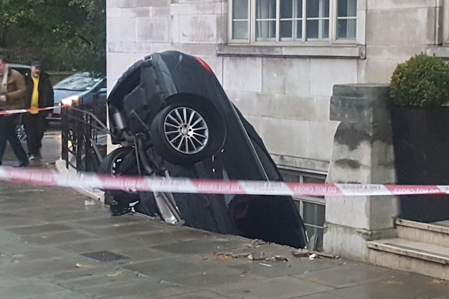 Car disastrously crashes into cellar outside tube station