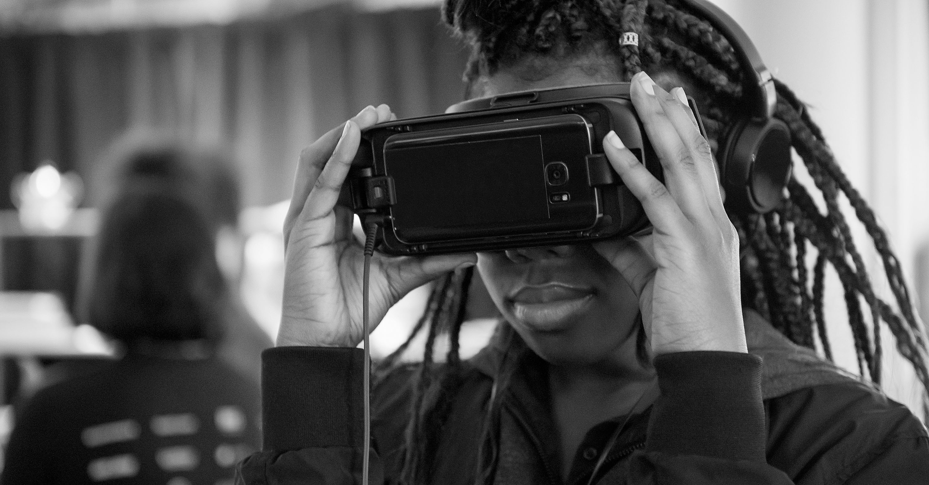 Young black student using Augmented Reality viewer