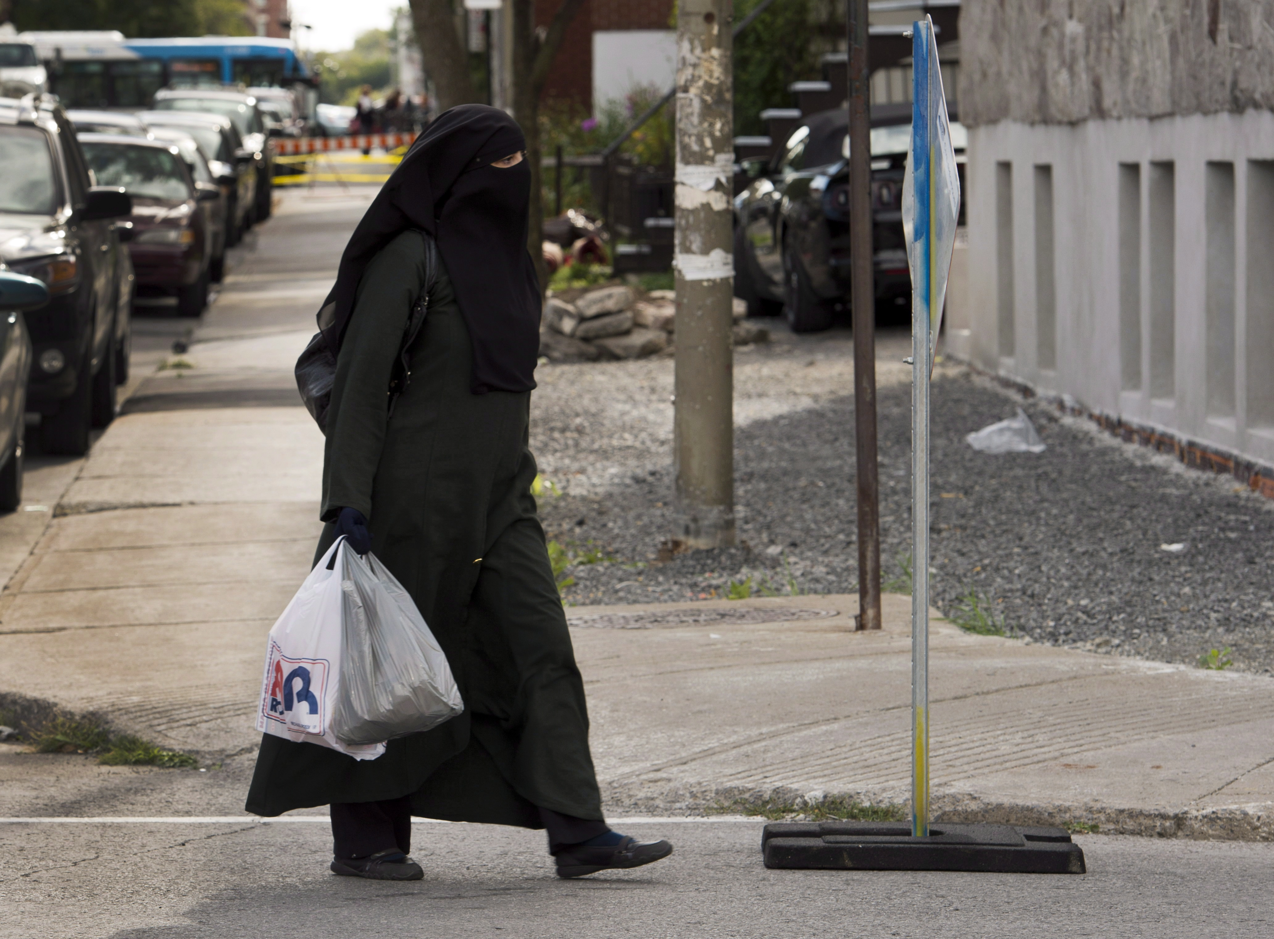 A woman wears a niqab as she walks on Sept. 9, 2013 in