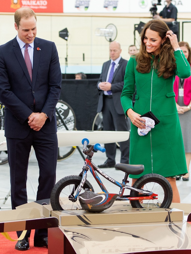 HAMILTON, NEW ZEALAND - APRIL 12:  Catherine, Duchess of Cambridge and Prince William, Duke of Cambridge are given a bike for Prince George as a gift as they visit the National Cycling Centre of Excellence and Avantidrome on April 12, 2014 in Hamilton, New Zealand. The Duke and Duchess of Cambridge are on a three-week tour of Australia and New Zealand, the first official trip overseas with their son, Prince George of Cambridge.  (Photo by Samir Hussein/WireImage)