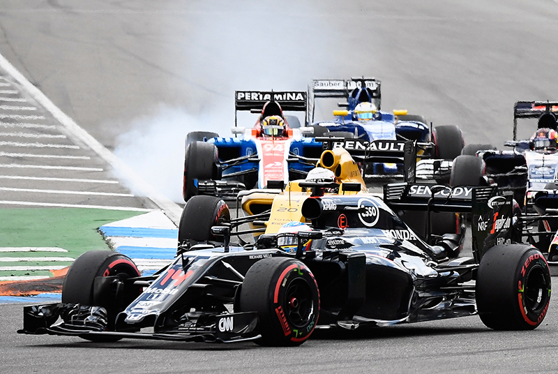 McLaren driver Fernando Alonso of Spain, foreground, takes a curve during the German Formula One Grand Prix in Hockenheim, Germany, Sunday, July 31, 2016.
