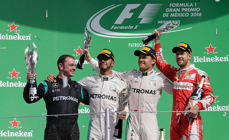 Paddy Lowe, engineer, technical director of Mercedes, race winning Mercedes driver Lewis Hamilton of Britain, second placed finisher Mercedes driver Nico Rosberg of Germany and third placed finishing Ferrari driver Sebastian Vettel of Germany (L to R) celebrate during the victory ceremony after the race