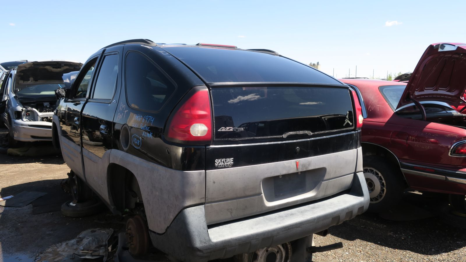 So it was a General Motors minivan-like vehicle cousin of the weird-looking Dustbusters of the 1990s with lots of useful features for those who did more ... & Junkyard Gem: 2001 Pontiac Aztek - Autoblog