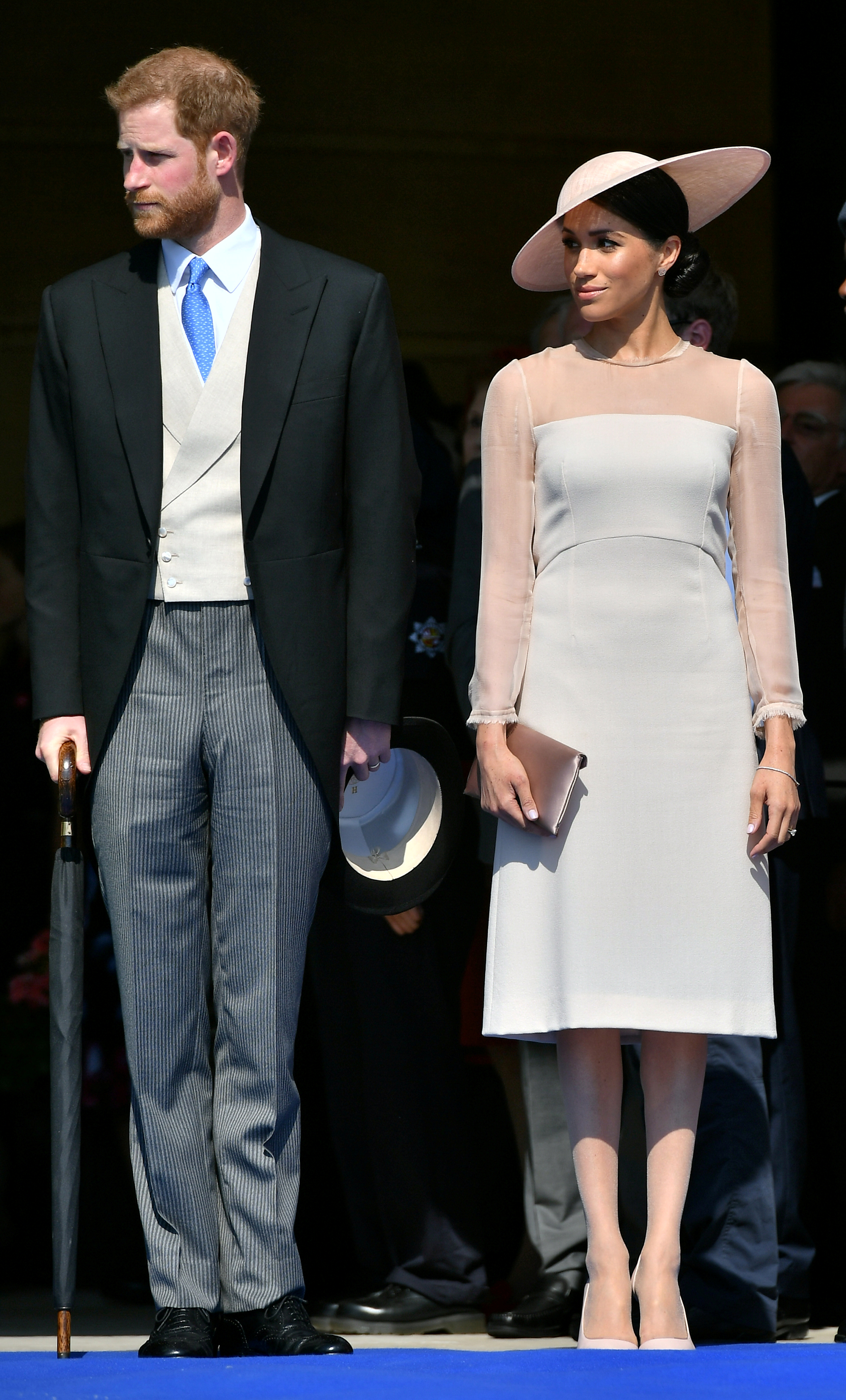 Britain's Prince Harry and his wife Meghan, Duchess of Sussex attend a garden party at Buckingham Palace,...