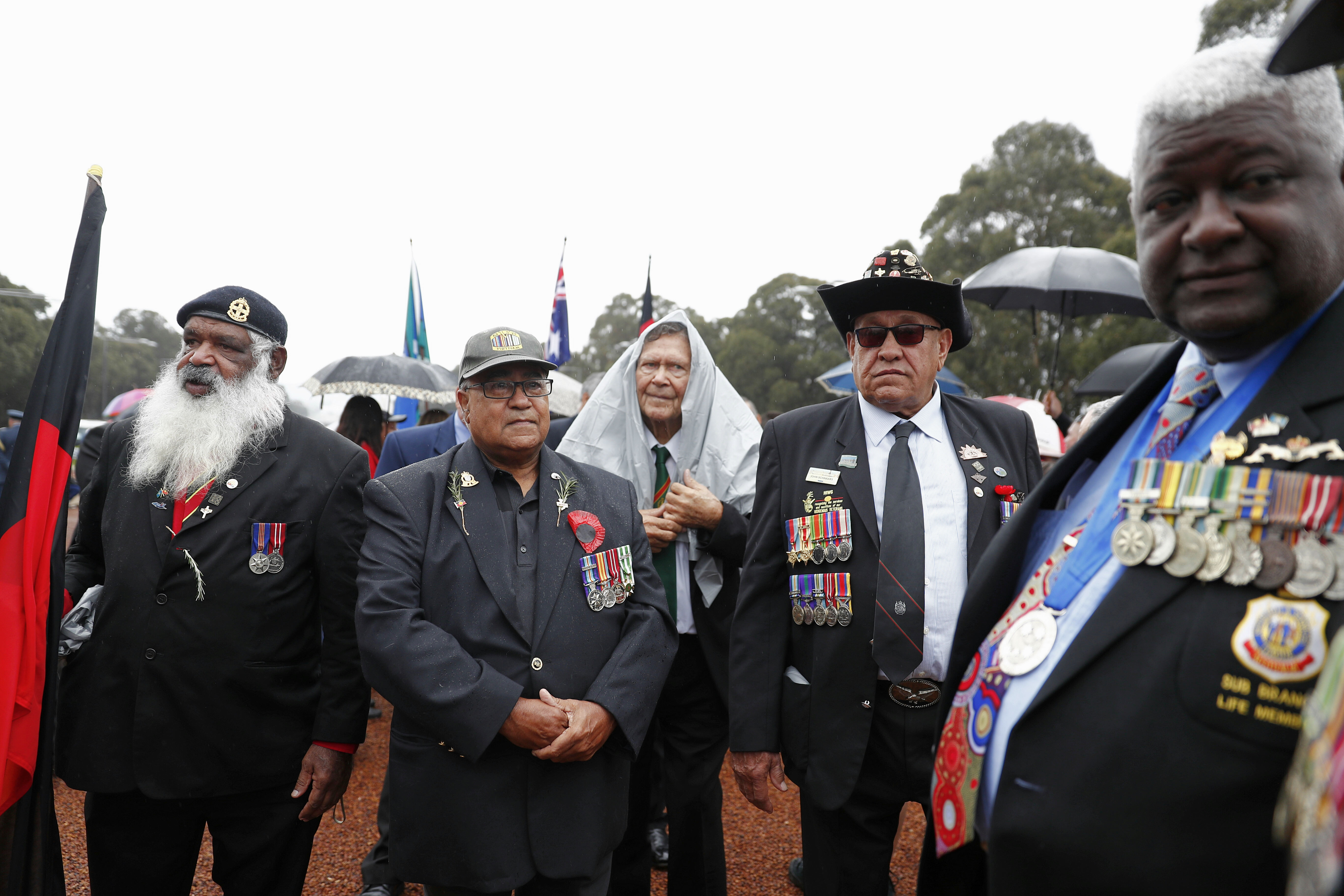 Ex-serviceman from the NSW Aboriginal and Torres Strait Islander Association get ready to march down...