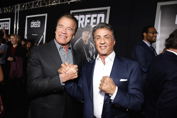 Arnold Schwarzenegger and Producer Sylvester Stallone seen at Los Angeles World Premiere of New Line Cinema's and Metro-Goldwyn-Mayer Pictures' 'Creed' at Regency Village Theater on Thursday, November 19, 2015, in Westwood, CA. (Photo by Eric Charbonneau/Invision for Warner Bros/AP Images)