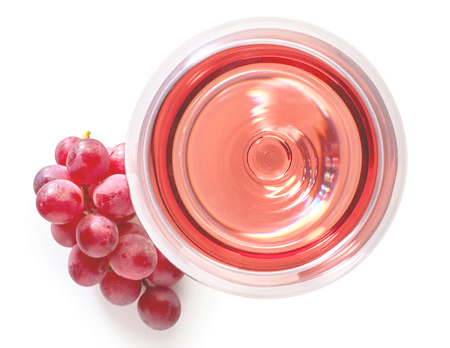 66842048 - glass of rose wine and grapes isolated on white background from top