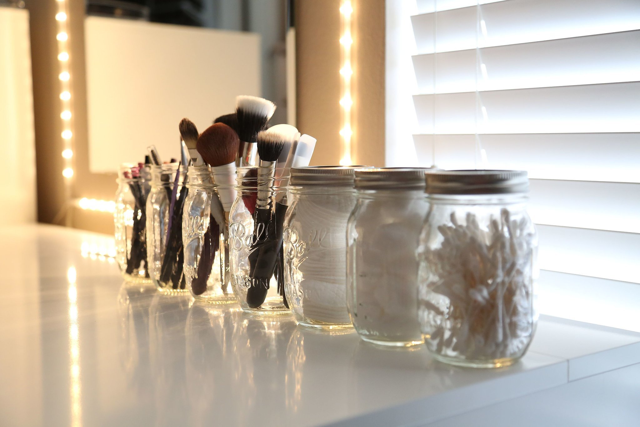 Makeup brushes in a mason jar