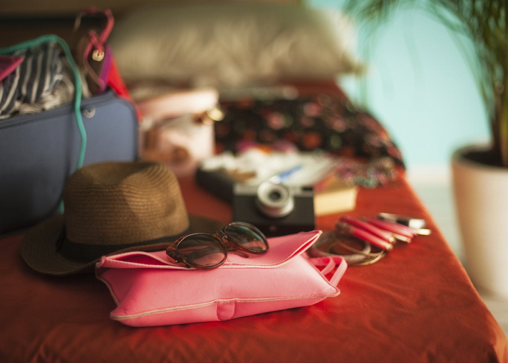 Holiday items on bed ready to pack