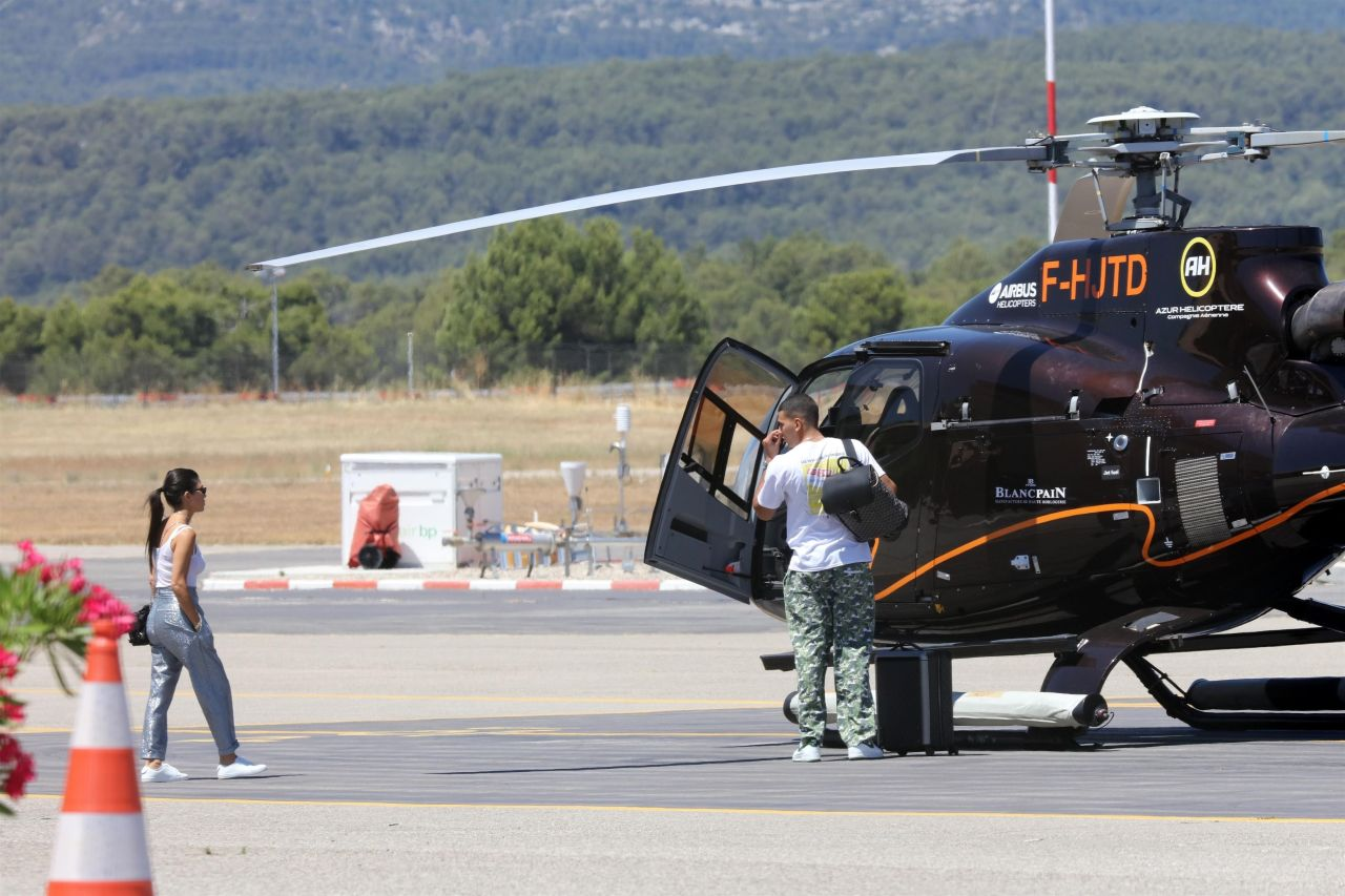 ** RIGHTS: ONLY UNITED STATES, CANADA ** Le Castellet, FRANCE  - Kourtney Kardashian and her boyfriend Younes Bendjima catch a helicopter at Le Castellet Airport.  Pictured: Kourtney Kardashian, Younes Bendjima  BACKGRID USA 5 JULY 2017   BYLINE MUST READ: Best Image / BACKGRID  USA: +1 310 798 9111 / usasales@backgrid.com  UK: +44 208 344 2007 / uksales@backgrid.com  *UK Clients - Pictures Containing Children Please Pixelate Face Prior To Publication*