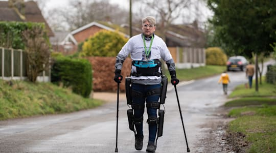 Paralysed man raises more than £12,000 for NHS with exoskeleton suit walk