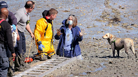 US nurse rescued after getting stuck in the mud during beach stroll