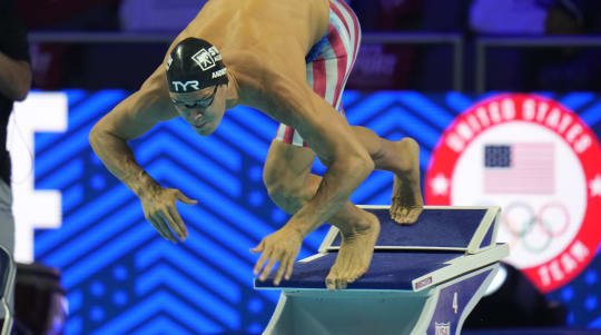 Unvaccinated swimmer sparks debate as Olympics start