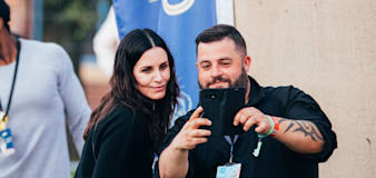 Courteney Cox poses for pictures with fans at Isle of Wight festival