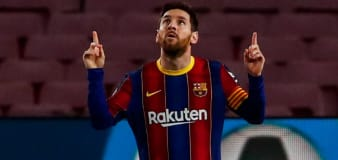 Lionel Messi scores twice as Barcelona cut gap to leaders Atletico Madrid