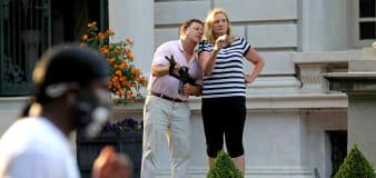 Governor pardons infamous gun-waving couple