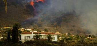 Volcano erupts on Atlantic island; lava destroys some homes