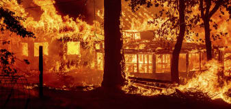 California fire torches homes as blazes lash West