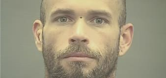 Man who wore horns at Capitol riot to remain jailed