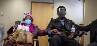 U.S. virus numbers drop, but race against new strains heats up