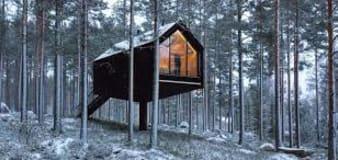 Futuristic cabin floats inside a Finnish forest
